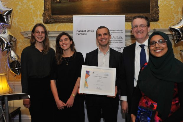 Here's a picture of our team winning the Cabinet Office Innovator Award in 2017. From left to right: Sophia and Rosa, two of our PhD placements, Chris Webber, head of our team, Rupert McNeil, Civil Service Chief People Officer, and Zahra Latif, who leads economic policy in the OIT.