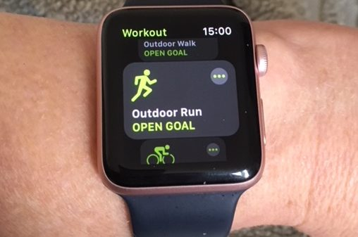 An Apple watch showing a running app on its screen.